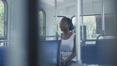 Woman sitting on bus looking out window
