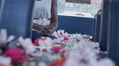 Woman on bus and aisle filled with flowers