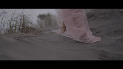 Woman In Pink Walking In The Dunes
