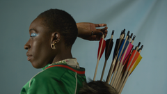 Woman Taking Arrow Out Of Quiver