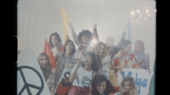A group of young women shouting with flags
