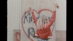 Woman finished spraying the heart