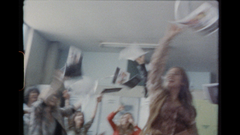 Group of women throwing papers in the air