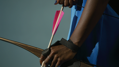 Woman with bow and arrow Close Up