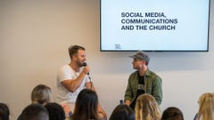 Two Men Presenting Social Media in Front of a Group