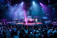 Wideshoot of the worship team leading worship on stage and with a choir in the middle of stage