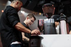 Two people at coffee station