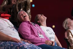Delegates laughing during pre-service comedy act
