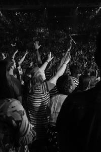 Crowd lifted hands in worship
