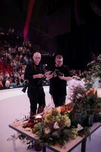 Photographers taking photos of the communion table displayed on center stage
