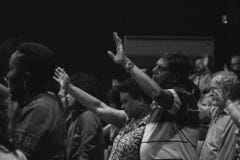 People worshiping with hand raised