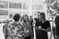 Women laughing and chatting outside