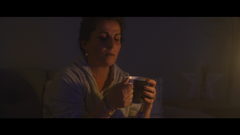 Woman Read Paperwork and Drink Tea