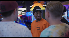 Guys Chatting At Arcade