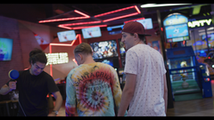 Guys Walking Through Arcade