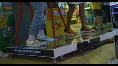 Guys Playing Dance Game At Arcade
