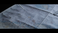 Metal Compass Pointing On Map